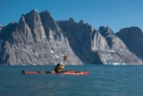 Paddling past Milne Land, East Greenland