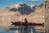 Sea kayaking off Milne Land, East Greenland