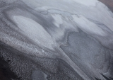 Old snow with ash patterns
