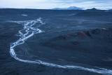 Frozen stream and distant peaks