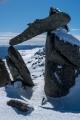 Teetering stone frames Mount Jagungal