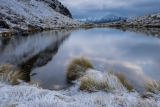 Tarn and snow, Livingstone Mountainsl